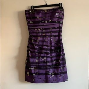 Purple dress with tulle and sequins detail.